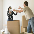 Couple unpacking boxes in new house — Stock Photo
