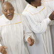 Stock Photo: Senior Africsinging in choir