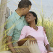 Middle-aged African couple hugging on beach — ストック写真