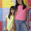 Stock Photo: Pacific Islander girls in front of mural