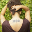 Stock Photo: Rear view of woman with tattoos
