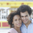 Stock Photo: Young couple smiling for the camera