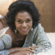 Portrait of African American woman laying down — Stock Photo