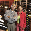 Royalty-Free Stock Photo: Portrait of couple in wine cellar