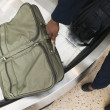 Businessmgrabbing luggage — Stockfoto #13230347