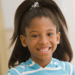 Stock Photo: Young girl smiling for the camera