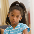 Stock Photo: Young girl pouting for the camera