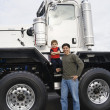 Stock Photo: Father standing with his son by their truck
