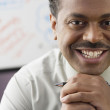 Close up of African businessman smiling — Stock Photo #13230435