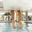 Feet dangling off end of diving board — Stock Photo #13230463