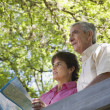 Senior couple with map outdoors — Stock Photo