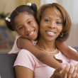 Stock Photo: Mother and daughter hugging