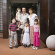 Hispanic family in doorway — Stockfoto