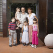 Hispanic family in doorway — Stock Photo