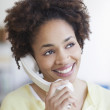 Young woman talking on the phone — Stock Photo #13230588