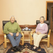 Senior Asian couple having tea — Stock Photo #13230603