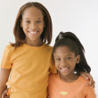 Sisters smiling for the camera — Stock Photo #13230608