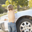 Young boy washing car — Foto Stock