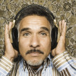 Close up portrait of man with headset listening to music — Stock Photo