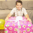 Hispanic boy with large gift — Stock Photo #13230747