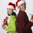 Portrait of young couple with gifts — Stock Photo