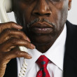 Businessman using telephone — Stock Photo