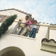 Foto Stock: Three males standing on home balcony