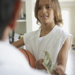 Father giving his son some money — Stock Photo
