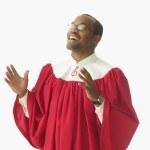 Man in choir robe singing — Stock Photo