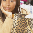 Close up of African American woman with shopping bag — Stock Photo #13230801