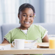 African American girl carrying breakfast tray — Stock Photo
