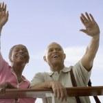 Couple waving goodbye — Stock Photo