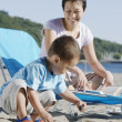 Stock Photo: Mother and son at the beach