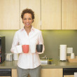 Stock Photo: Portrait of businesswomcarrying coffee cups