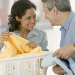 Stock Photo: Couple folding laundry