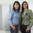 Two young women smiling at camera — Stock Photo