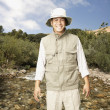 Explorer standing in riverbed — Stock Photo