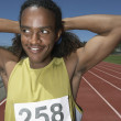 Male track athlete stretching before race — Stock Photo #13230921