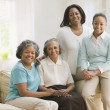 Multi-generational Africwomen sitting on sofa — Stockfoto #13230933