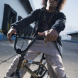 African male breakdancer on bicycle — Stock Photo