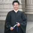 Young male graduate holding degree — Stok Fotoğraf #13230980