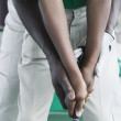 Close up of father and son's hands golfing — Stock Photo