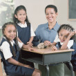 Foto Stock: Young school girls with teacher