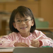 Portrait of young girl smiling in classroom — Stok fotoğraf