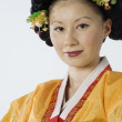 Young Asian woman in traditional dress - Stock Photo