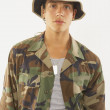 Portrait of young male soldier in fatigues - Stock Photo