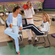 Young women relaxing at bowling alley — Stock Photo #13231095