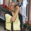 Elderly man with video camera — Stock Photo
