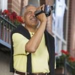 Elderly man with video camera — Stock Photo