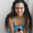 Portrait of young woman with cell phone — Foto de Stock